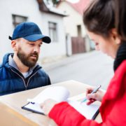 Delivery driver with customer signing VAT form